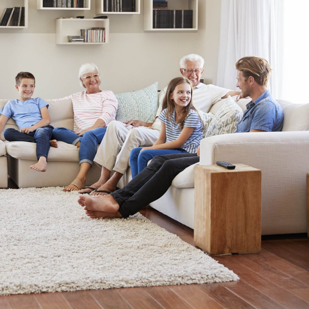 Family spending time together in living room | Yuma Carpets